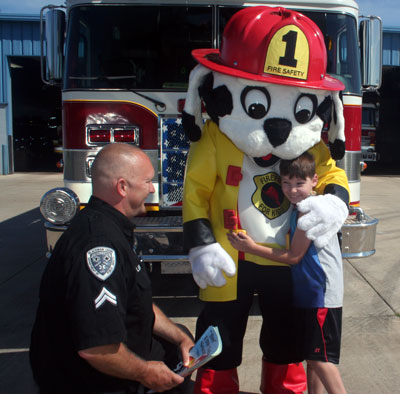 firepup mascot costume with firefighter and boy 2015
